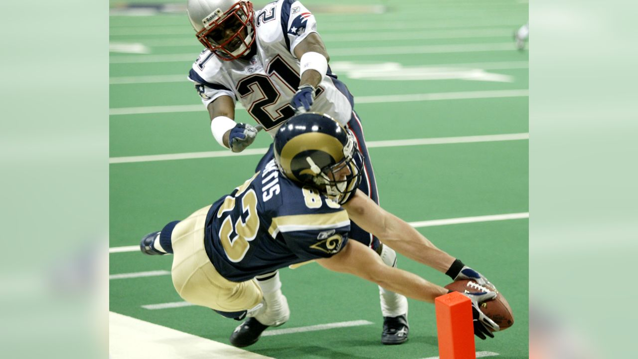 St. Louis' Rams Kevin Curtis (83) reaches for the end zone in his attempt to score a touchdown pass from quarterback Marc Bulger in the fourth quarter against the New England Patriots' Randall Gay (21) in their NFL game in St. Louis Sunday, Nov. 7, 2004. The Patriots challeged the touchdown and the score was called back. The Patriots defeated the Rams by the final score of 40-22. (AP Photo/James A. Finley)