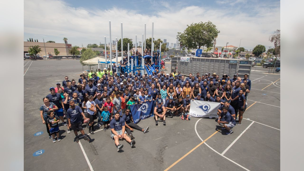 Los Angeles Rams front office and players pose for a group picture at a Playground Build at 20th Street Elementary School, Friday, June 15, 2018, in Los Angeles, CA. (Jeff Lewis/Rams)