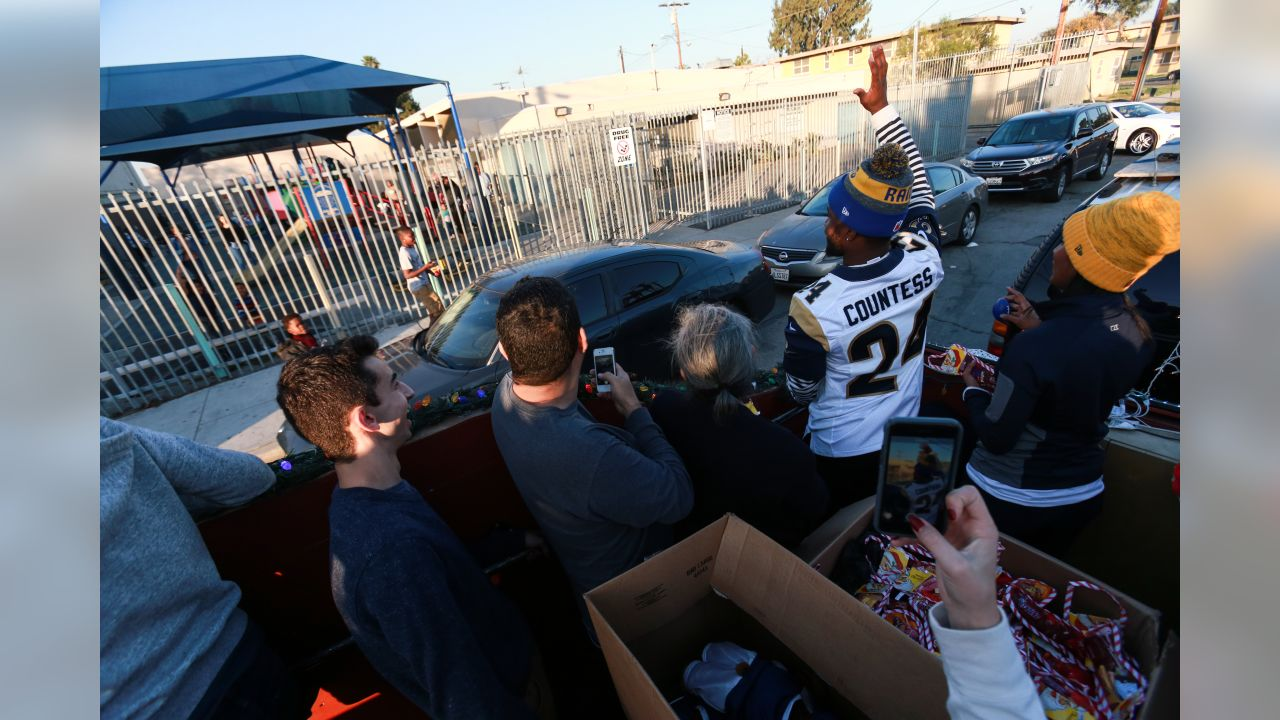 The Los Angeles Rams Community members joined by Safety (43) John Johnson III and Defensive back (24) Blake Countess team up with South LA Los Angeles Police Department to ride in Santa's Sleigh to distribute cheer and stockings of candy to local communities. Tuesday, December 11, 2018, Los Angeles, CA. (Will Navarro/Rams)