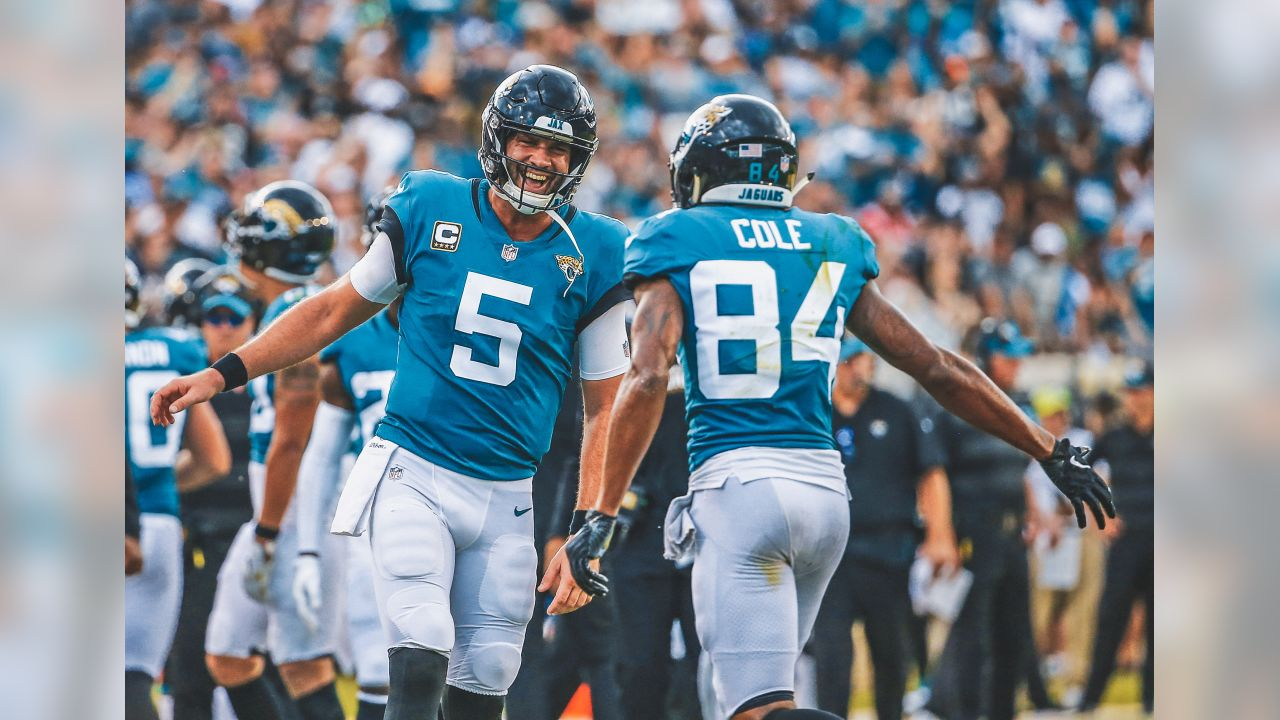 FILE - In this Sunday, Sept. 16, 2018, file photo, Jacksonville Jaguars quarterback Blake Bortles (5) celebrates his touchdown pass to wide receiver Keelan Cole (84) during the first half of an NFL football game against the New England Patriots in Jacksonville, Fla. The Jaguars might as well dub this the Payback Tour 2018. It started last week against when Jaguars won against two-time defending AFC champion New England. Now, the Jaguars get AFC South rival, the Tennessee Titans. (AP Photo/Stephen B. Morton)