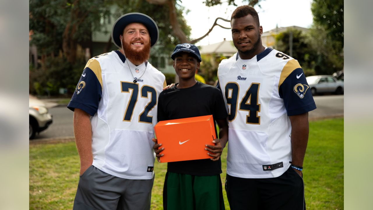 Los Angeles Rams offensive lineman Aaron Neary and defensive lineman John Franklin-Myers surprise the Kayne Era Center bulldogs at practice with football equipment and cleats in Culver City, Calif. on October 2nd, 2018. The Kayne Era Center (KEC) is a nonpublic special education school for students in grades k-12 (Hiro Ueno/Rams).