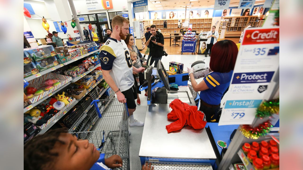 Punter (06) Johnny Hekker of the Los Angeles Rams join the Rams volunteer team as they've partnered with Salvation Army welcome local youth to spend time and shop with L.A. Rams players, cheerleaders, Rampage, and Community Service team members for their holiday wish list. (Will Navarro/Rams)