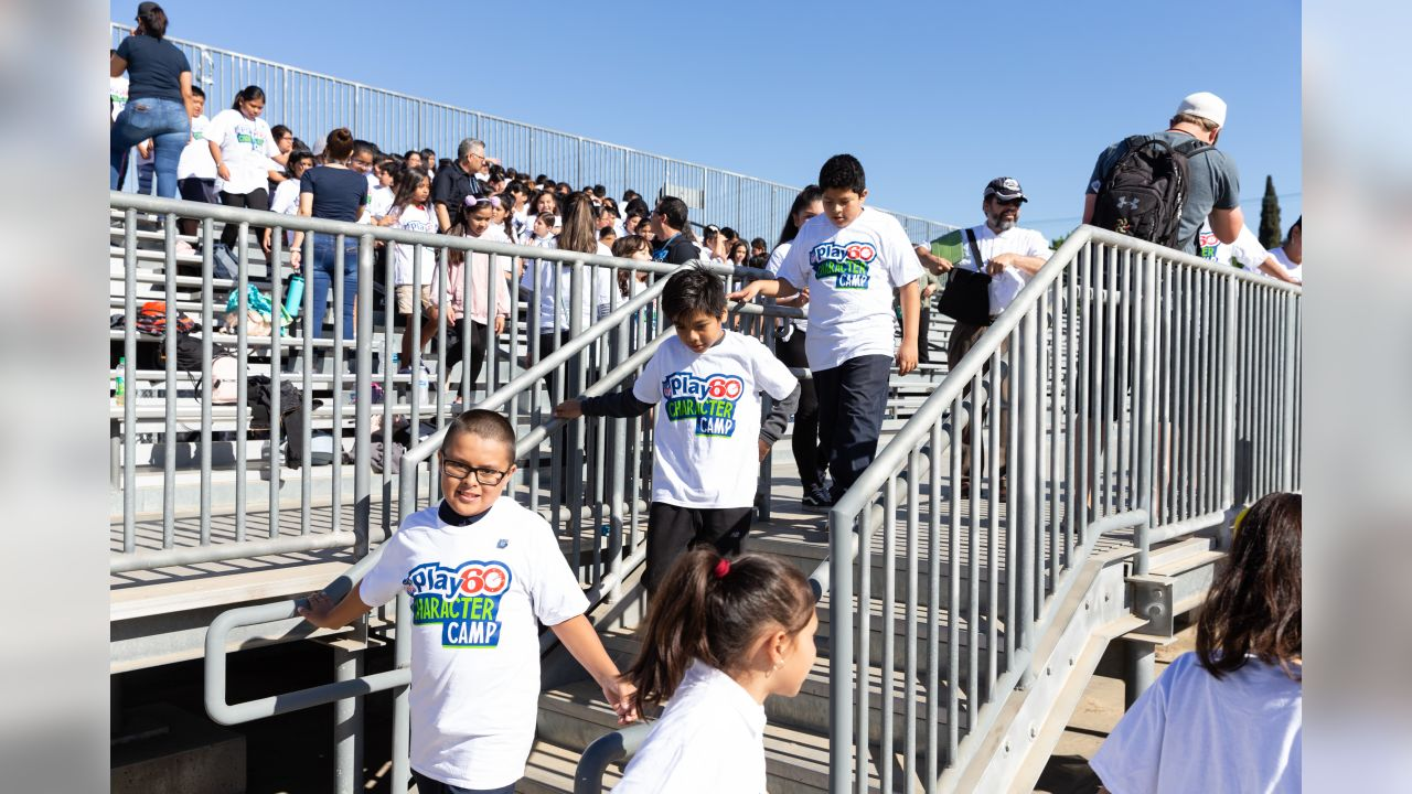 The Los Angeles Rams, in partnership with the NFL, host an NFL PLAY 60 Character Camp at Roosevelt High School in Los Angeles, CA. The Rams will host approximately 300 Hispanic youth, ages 9-13, with little or no football experience for the free camp joined by Rams Cheerleaders and Rampage. Tuesday, September 18, 2018. (Will Navarro/Rams)