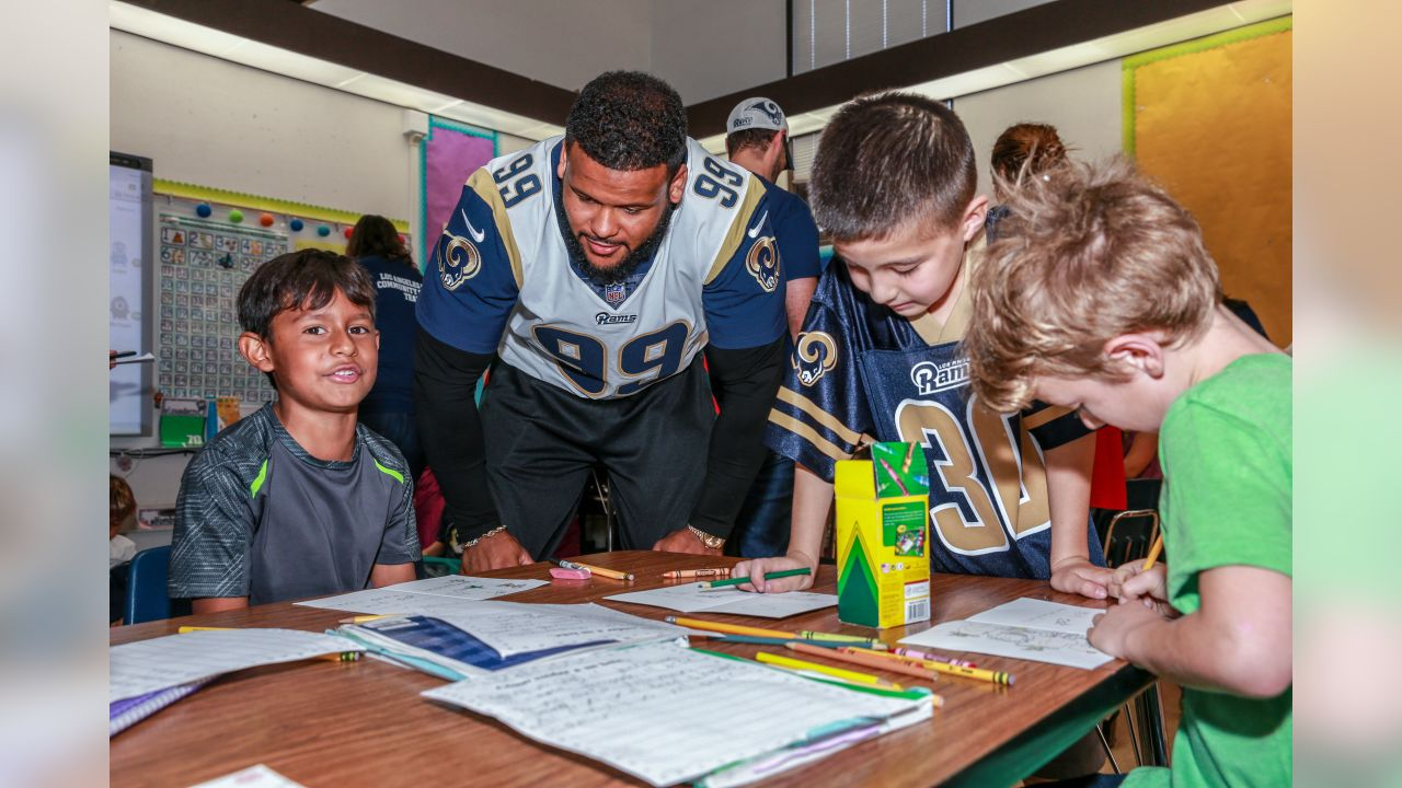 Defensive end (99) Aaron Donald and the Los Angeles Rams team up with the American Red Cross with Holiday Heroes as Rams players visit Sumac Elementary school to sit down with kids and write Holiday and Thank you cards to overseas Armed Forces service members. Tuesday, November 06, 2018, Agoura Hills, CA. (Will Navarro/Rams)