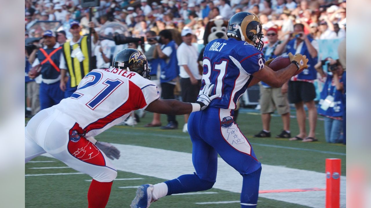 Torry Holt runs for a touchdown during the 2004 Pro Bowl. The NFC won 55-52. (AP photo Ronen Zilberman)