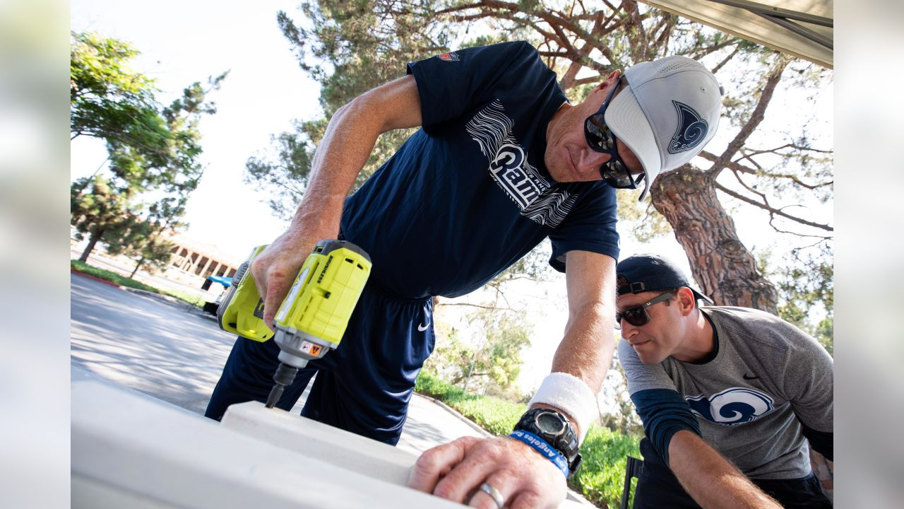 Special Teams Coordinator John Fassel of The Los Angeles Rams works with Habitat for Humanity Orange County to build playhouses to be auctioned off at practice at The University of California Irvine in Irvine, CA on 8/3/2018. (Rams/Hiro Ueno)