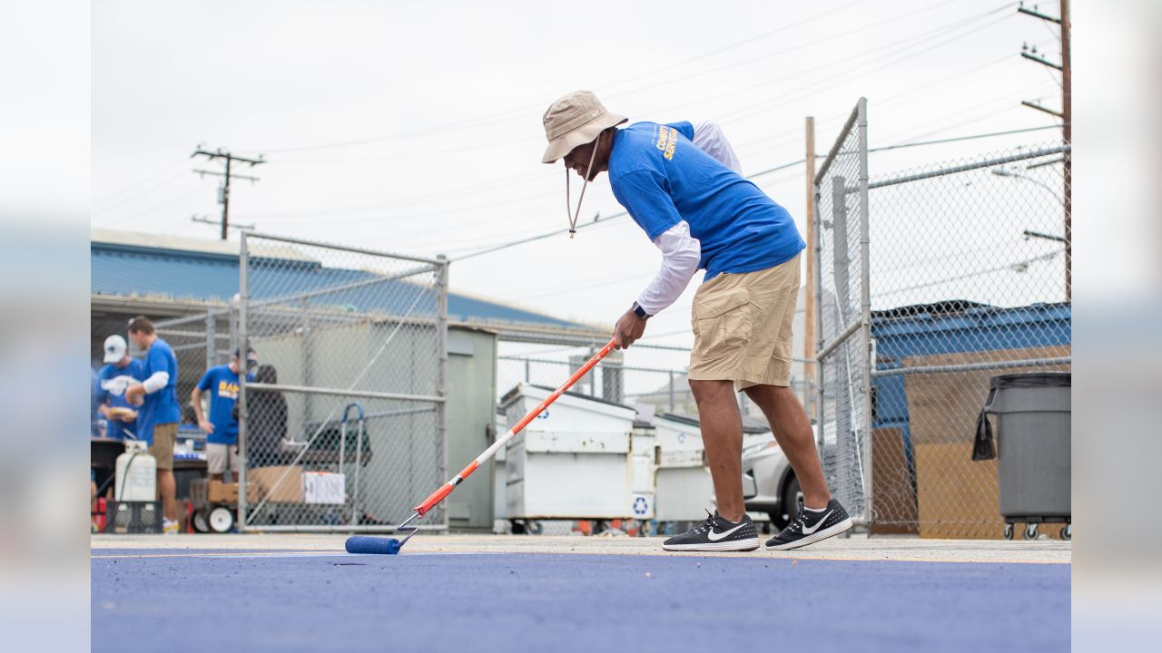 Artis Twyman of the Los Angeles Rams help build a playground and murals at Belvedere Elementary School, Friday June 14, 2019, in Los Angeles, CA. (Jeff Lewis/Rams)