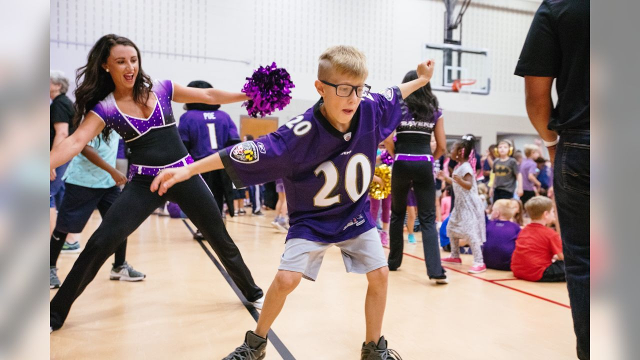 September 8, 2018 Purple Friday Caravan at Magnolia Elementary School, Riverside Elementary School, and Joppatowne Elementary School. Cheerleaders, band and Poe entertained the children.