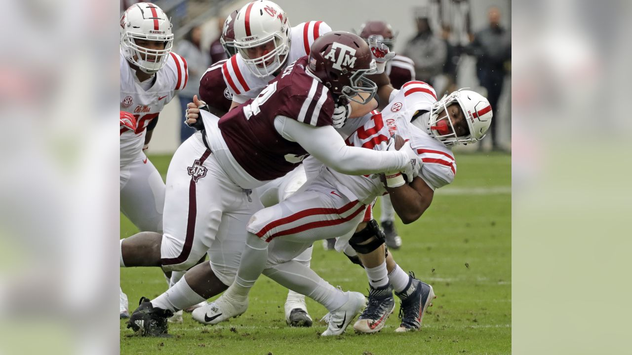 Texas A&M defensive lineman Daylon Mack, left, tackles Mississippi Rebels running back Isaiah Woullard (26) during the first half of an NCAA college football game Saturday, Nov. 10, 2018, in College Station, Texas. (AP Photo/David J. Phillip)