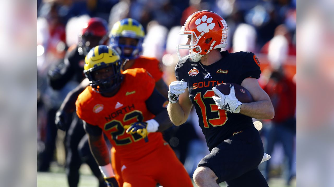 South wide receiver Hunter Renfrow, right, of Clemson, carries the ball against the South during the first half of the Senior Bowl college football game, Saturday, Jan. 26, 2019, in Mobile, Ala. (AP Photo/Butch Dill)