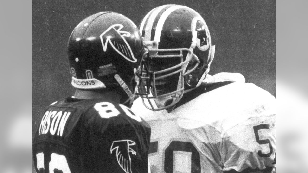 Washington Redskins linebacker Wilbur Marshall (58) confronts Atlannta Falcons wide receiver Andre Rison (80) during first quarter NFL Divisional playoff action, at RFK stadium in Washington, Jan. 4, 1992. (AP Photo/Doug Mills)
