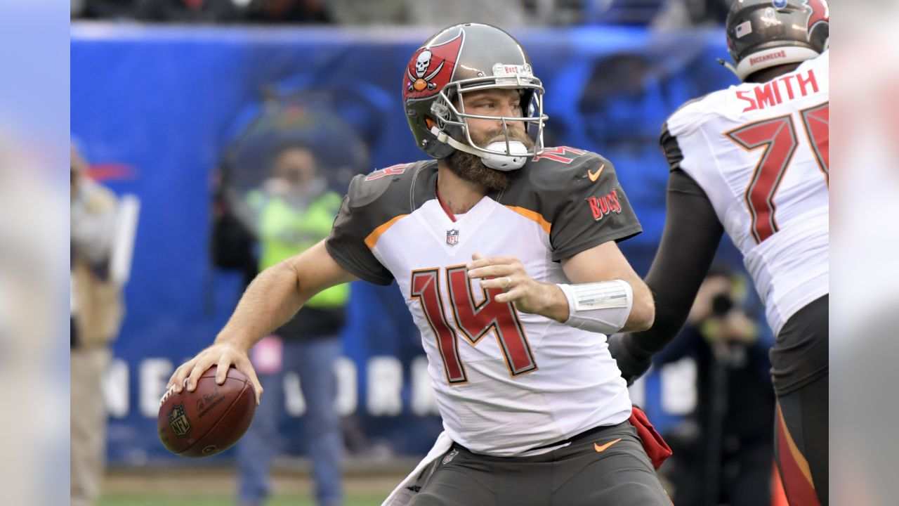 Tampa Bay Buccaneers quarterback Ryan Fitzpatrick (14) looks to pass during the first half of an NFL football game against the New York Giants, Sunday, Nov. 18, 2018, in East Rutherford, N.J. (AP Photo/Bill Kostroun)