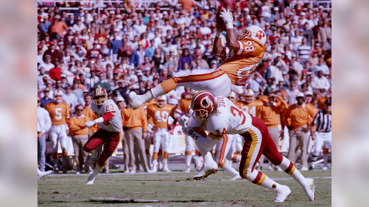 Washington Redskins cornerback Brian Davis (34) upends Tampa Bay Buccaneers wide receiver Mark Carrier (88) after he caught a Vinny Testaverde pass during first quarter action at RFK Stadium in Washington, D.C., Oct. 22, 1989. (AP Photo/Doug Mills)