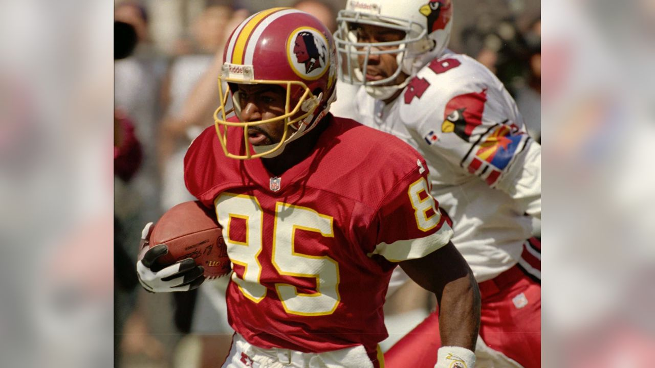 The Washington Redskins' Henry Ellard (85) beats Arizona Cardinals defensive back Brent Alexander into the end zone for a touchdown during the first quarter of their NFL game Sunday, Oct. 15, 1995 in Tempe, Ariz.  (AP Photo/Jeff Robbins)
