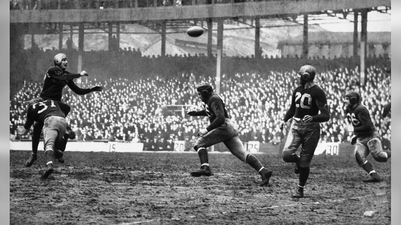 Sam Baugh, passing star of the Washington Redskins, flips an aerial for a 12-yard gain during the Redskins' 49-14 rout of the New York Giants on Dec. 6, 1937 in New York. Baugh, being tackled by Ray Hanken (37) of the Giants a moment after getting the ball away, completed 11 passes for a total gain of 135 yards and ran his total completions for the regular season to 81, a new national league record. (AP Photo)