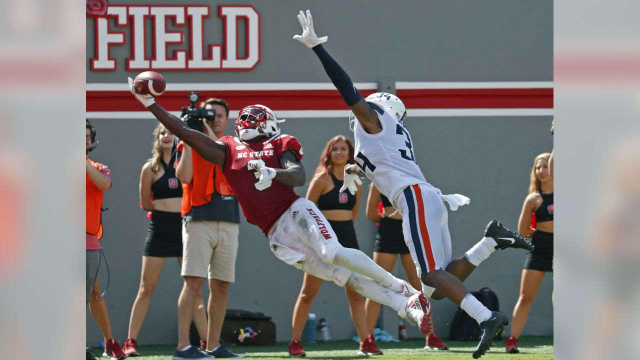 North Carolina State's Kelvin Harmon (3) can't quite make the catch as he is defended by Virginia's Bryce Hall (34) during the second half of an NCAA college football game in Raleigh, N.C., Saturday, Sept. 29, 2018. (AP Photo/Chris Seward)