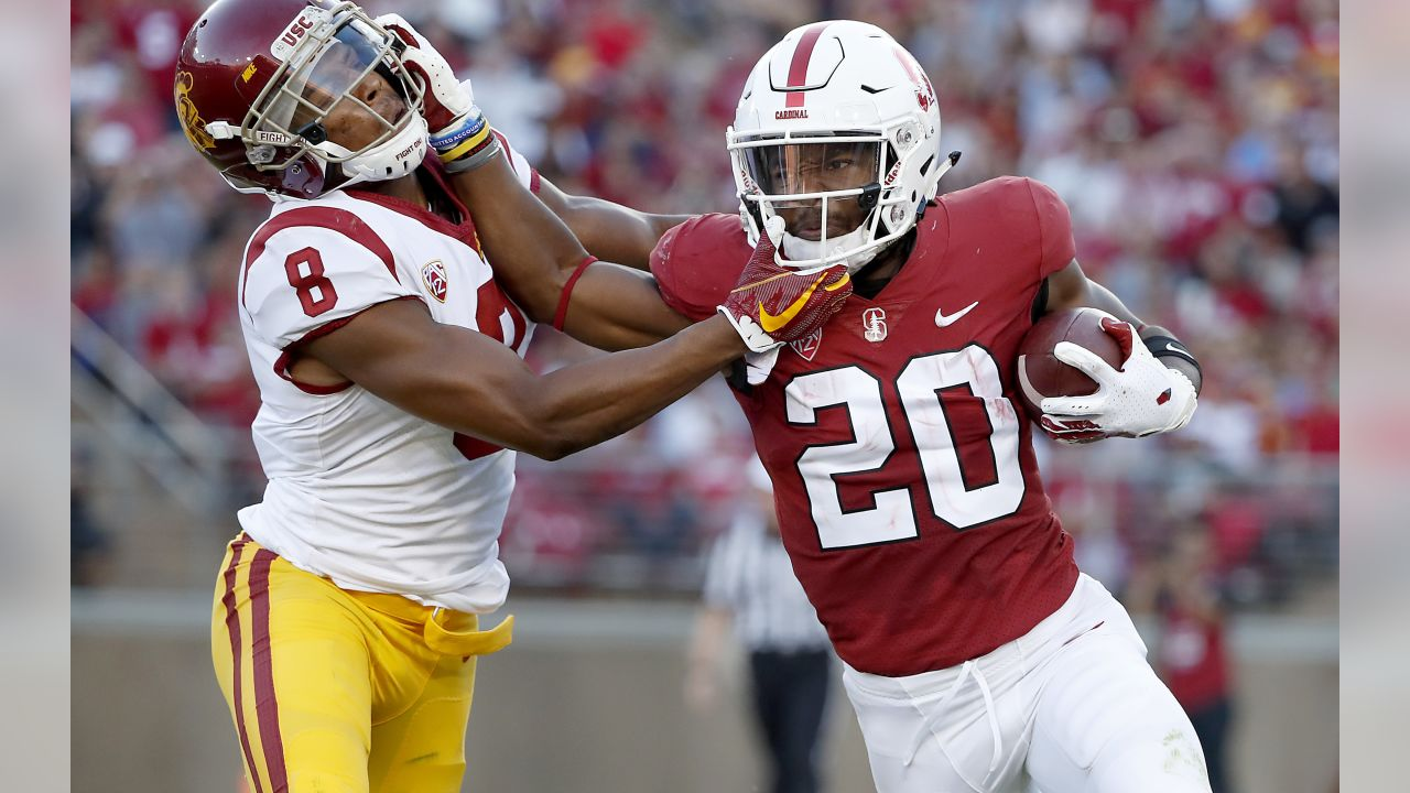 Stanford running back Bryce Love (20) stiff-arms Southern California cornerback Iman Marshall (8) during the first half of an NCAA college football game, Saturday, Sept. 8, 2018, in Stanford, Calif. (AP Photo/Tony Avelar)