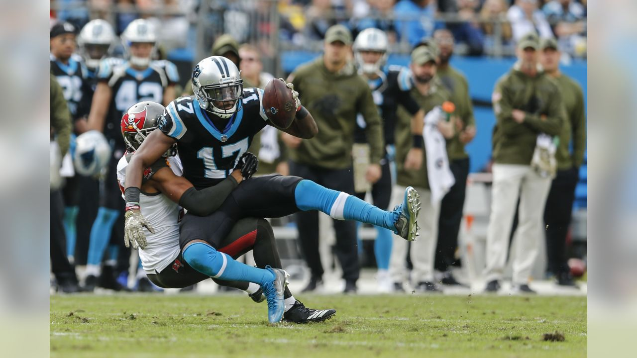 Tampa Bay Buccaneers cornerback Carlton Davis tackles Carolina Panthers wide receiver Devin Funchess (17) in an NFL football game in Charlotte, N.C., Sunday, Nov. 4, 2018. (AP Photo/Nell Redmond)