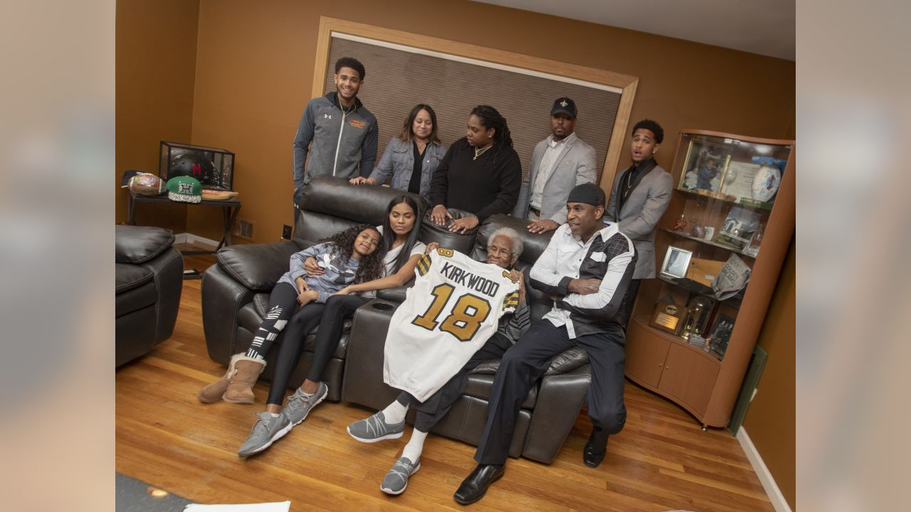 The Kirkwood family poses for a family photograph in the living room of New Orleans Saints wide receiver Keith Kirkwood's childhood home in Neptune Township, New Jersey.