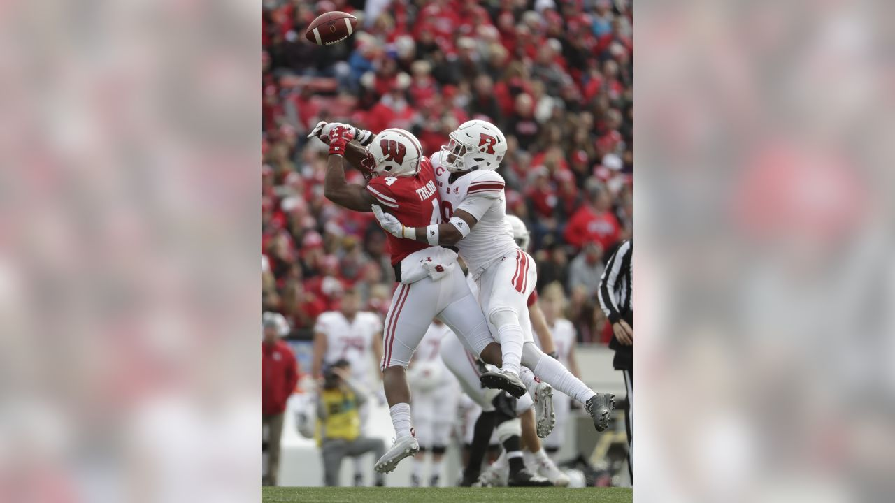Rutgers's Saquan Hampton breaks up a pass intended for Wisconsin's A.J. Taylor during the first half of an NCAA college football game Saturday, Nov. 3, 2018, in Madison, Wis. (AP Photo/Morry Gash)