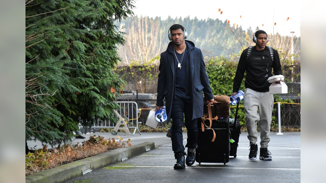 Seahawks Russell Wilson and DeShawn Shead walk from the practice facility to the buses for the start of the road trip to Dallas to face the Cowboys in Week 16.