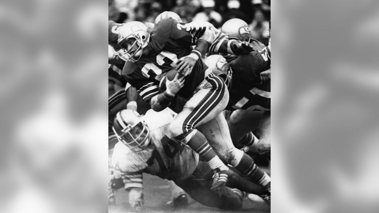 Seattle Seahawks fullback Dan Doornink (33) runs upfield during an NFL game against the San Francisco 49ers in San Francisco, Oct. 7, 1979. The Seahawks defeated the 49ers 35-24. (AP Photo/Al Messerschmidt)