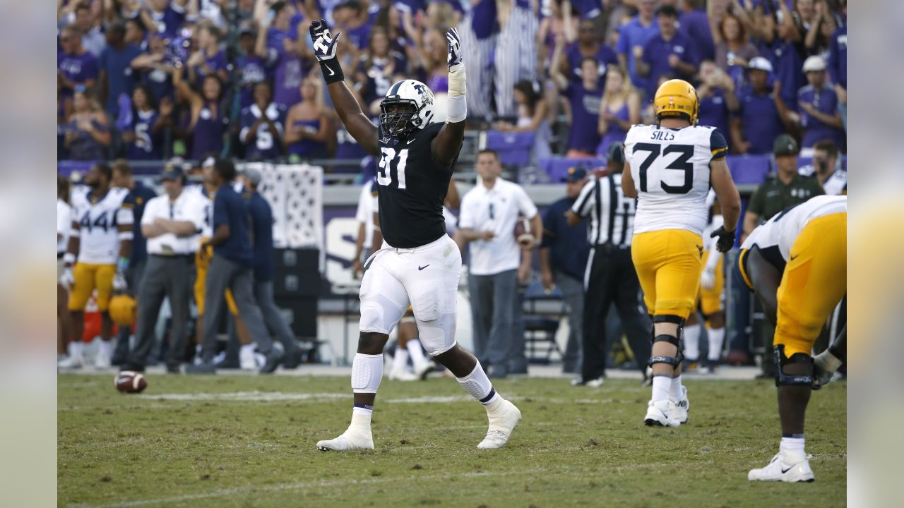 TCU defensive tackle L.J. Collier (91) celebrates as TCU plays West Virginia late in the fourth quarter of an NCAA college football game Saturday, Oct. 7, 2017, in Fort Worth, Texas. TCU won 31-24. (AP Photo/Ron Jenkins)