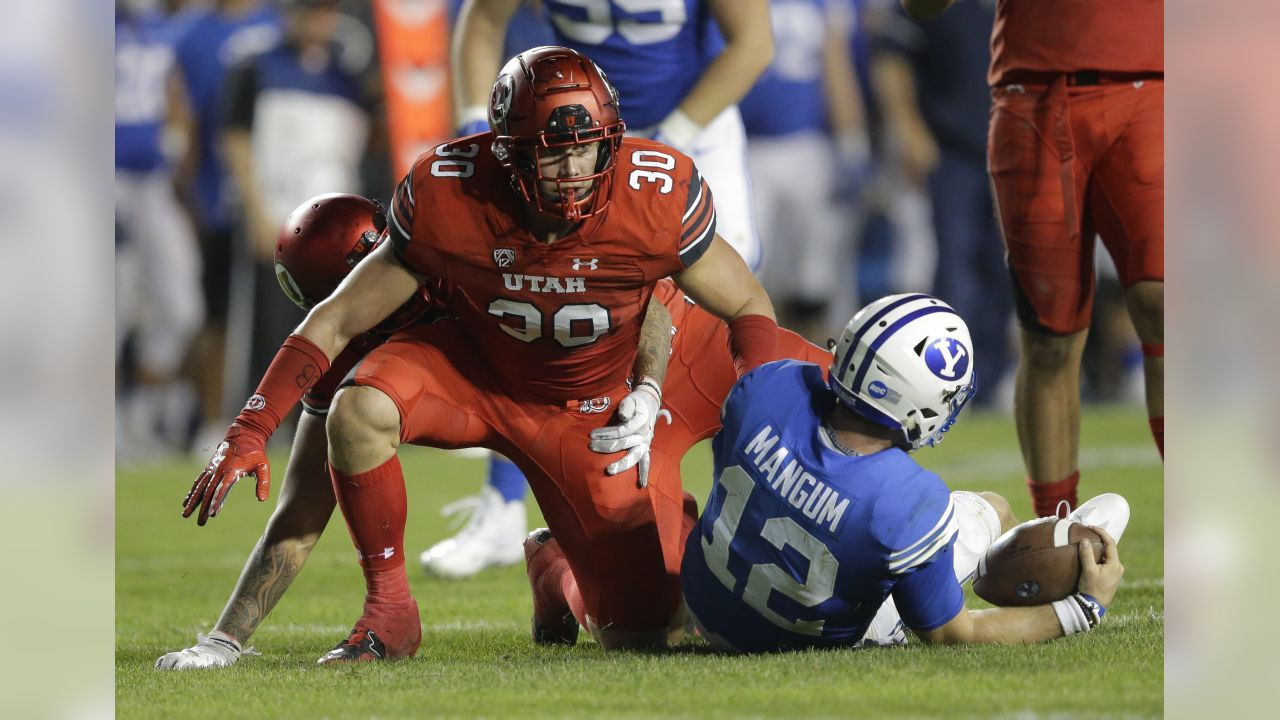 Utah linebacker Cody Barton (30) looks on after sacking BYU quarterback Tanner Mangum, right, in the second half during an NCAA college football game Saturday, Sept. 9, 2017, in Provo, Utah. Utah won 19-13. (AP Photo/Rick Bowmer)