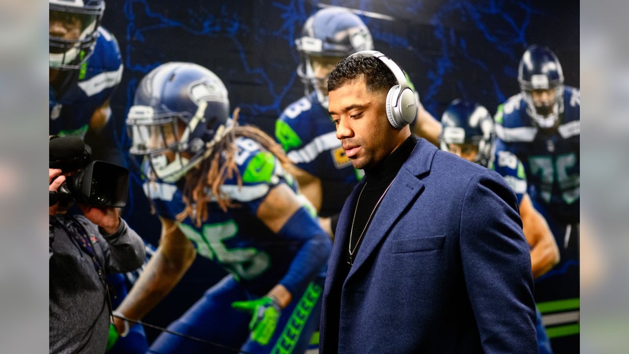 Seahawks quarterback Russell Wilson arrives at CenturyLInk Field and walks by a mural next to the team's locker room.