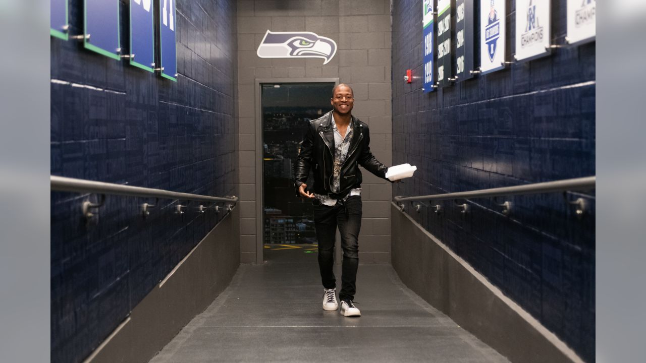 Receiver Tyler Lockett makes his way up the hallway leading to the locker room after his arrival Sunday morning at CenturyLink Field.