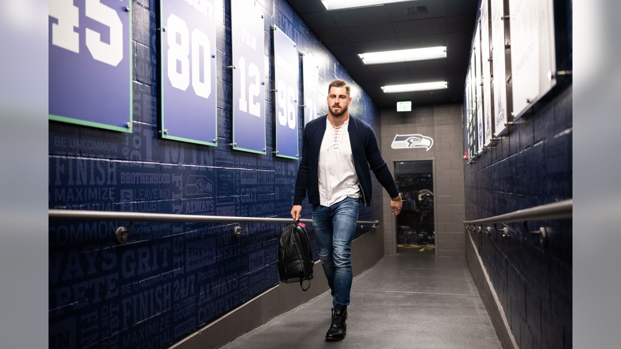 Tight end Nick Vannett arrives at CenturyLink Field and walks the hallway from the players parking lot to the locker room.