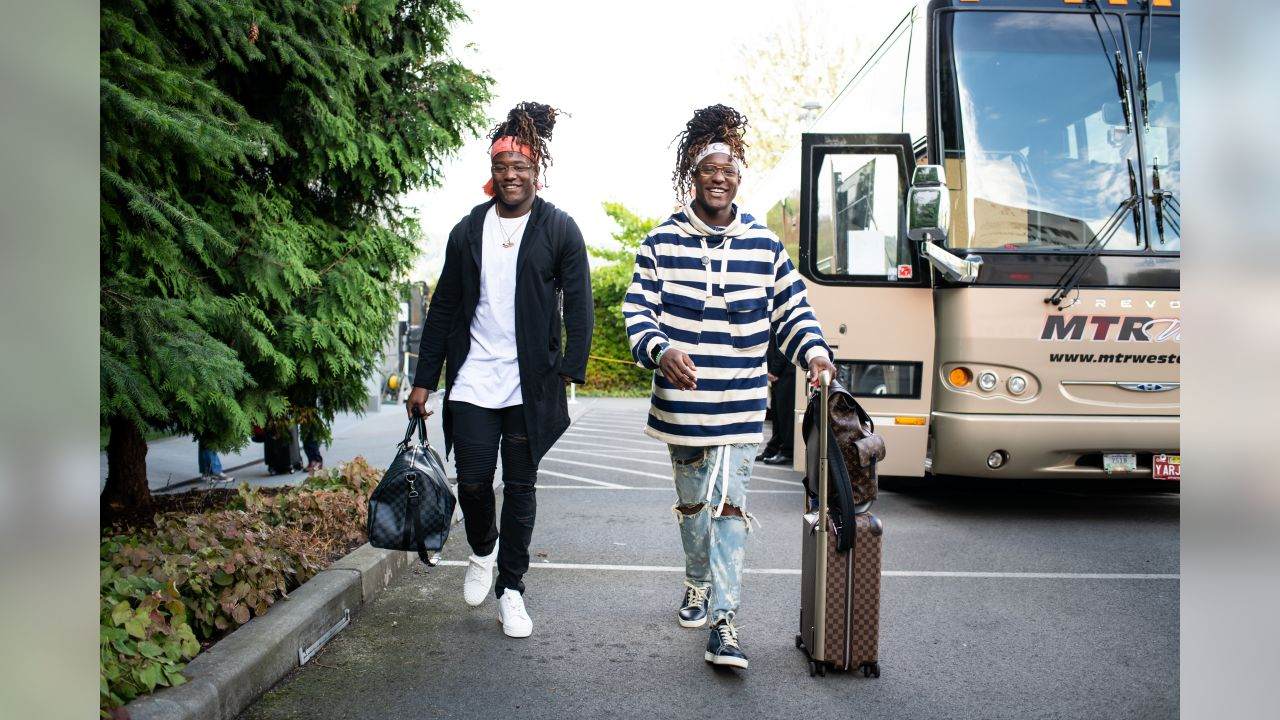 Shaquem and Shaquill Griffin head for the team buses to begin the trip from Seattle for the Week 4 game against the Arizona Cardinals.