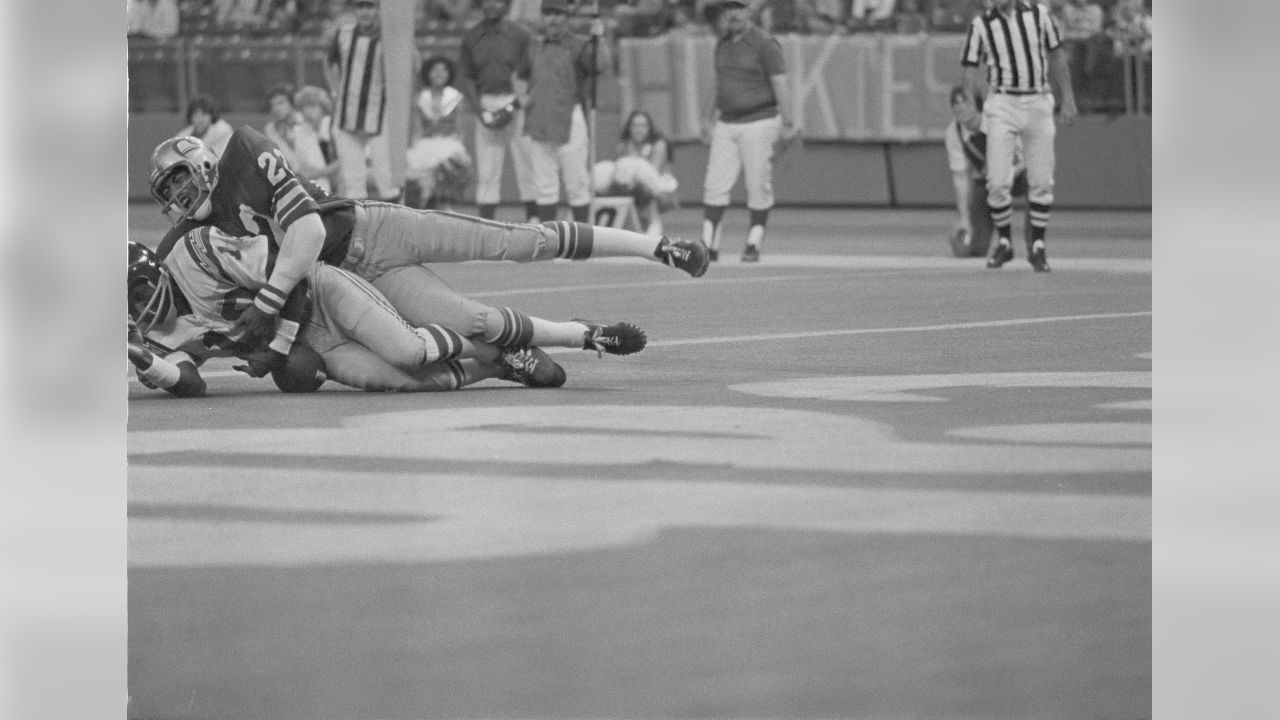 San Diego Charger Charlie Joiner traps a Dan Fouts' pass in the end zone early in the second quarter in Seattle, Nov. 27, 1977. Joiner argued with officials, claiming he had caught the ball. Defending is Seahawk defensive back Dave Brown.  (AP Photo/Yarnold)