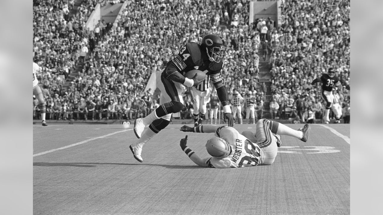 Chicago Bears running back Walter Payton (34) leaves Seattle Seahawks cornerback Cornell Webster (38) sprawling as he gains 11 yards with a pass from quarterback Bob Avellini in first quarter, Sunday, Nov. 5, 1976 in Chicago. Play was good for a first down. (AP Photo/Fred Jewell)