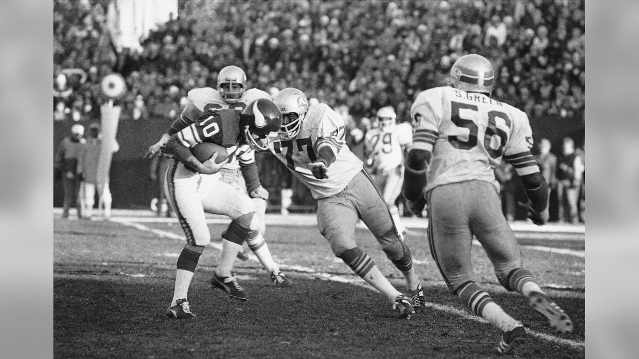 Fran Terkenton, Minnesota Vikings Quarterback, is about to be sacked by Seattle Seahawks tackle Dick Harris (77) on Dec. 14, 1976. (AP Photo)