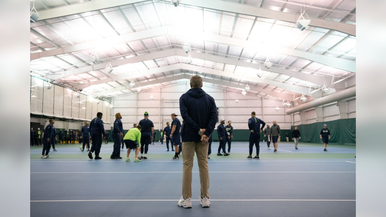 On Saturday afternoon in Detroit, Seahawks head coach Pete Carroll watches his team undergo their walkthru at a nearby university's indoor facility due to inclement weather.
