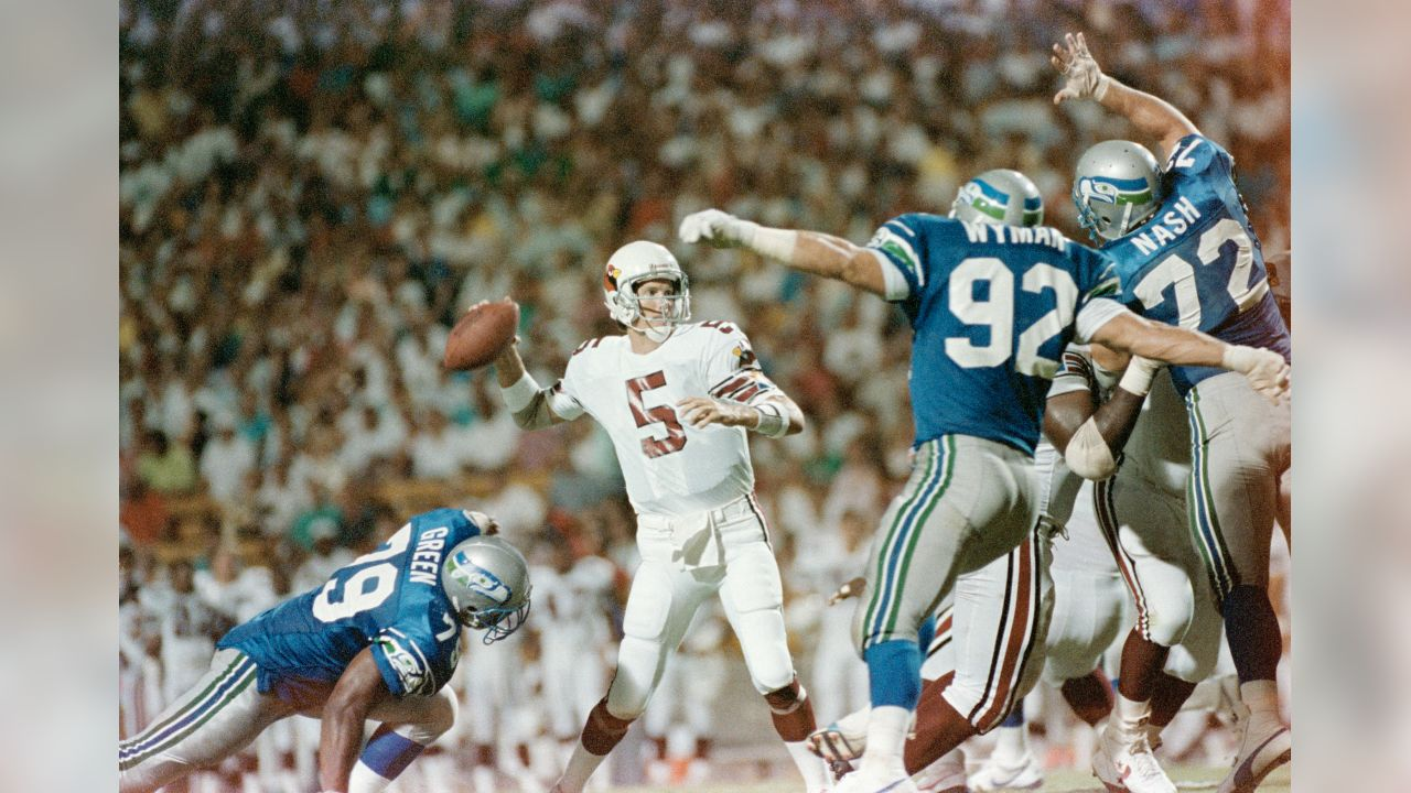 Phoenix Cardinals quarterback Gary Hogeboom can't find a receiver due to heavy defensive pressure from Seattle Seahawks (92) David Wyman and (72) Joe Nash during action in their pre-season game, Aug. 12, 1989 in Tempe, Arizona. The Seahawks proved too much for the Cardinals after the game went into overtime and lost 16-10. (AP Photo/Chad Surmick)