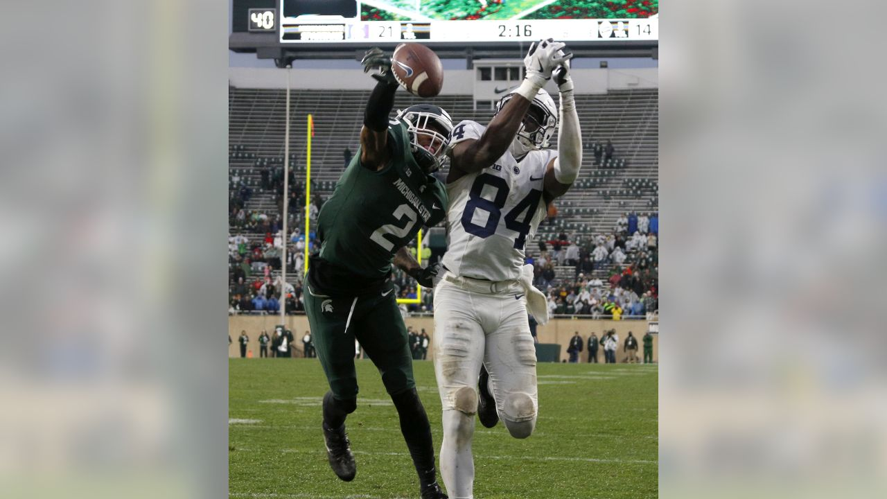 Michigan State's Justin Layne, left, breaks up a pass intended for Penn State's Juwan Johnson (84) during the third quarter of an NCAA college football game, Saturday, Nov. 4, 2017, in East Lansing, Mich. Michigan State won 27-24. (AP Photo/Al Goldis)
