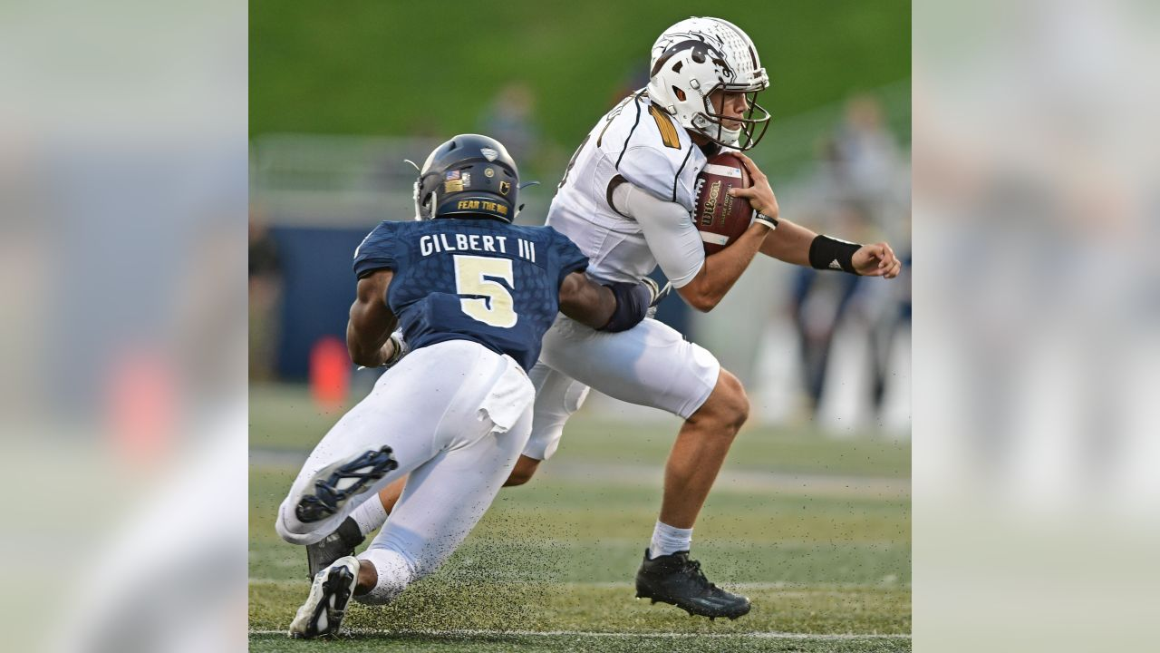 Western Michigan quarterback Zach Terrell, right, is tackled by Akron linebacker Ulysses Gilbert III (5) in the third quarter of an NCAA college football game against XXXX on Saturday, Oct. 15, 2016, in Akron, Ohio. (AP Photo/David Dermer)