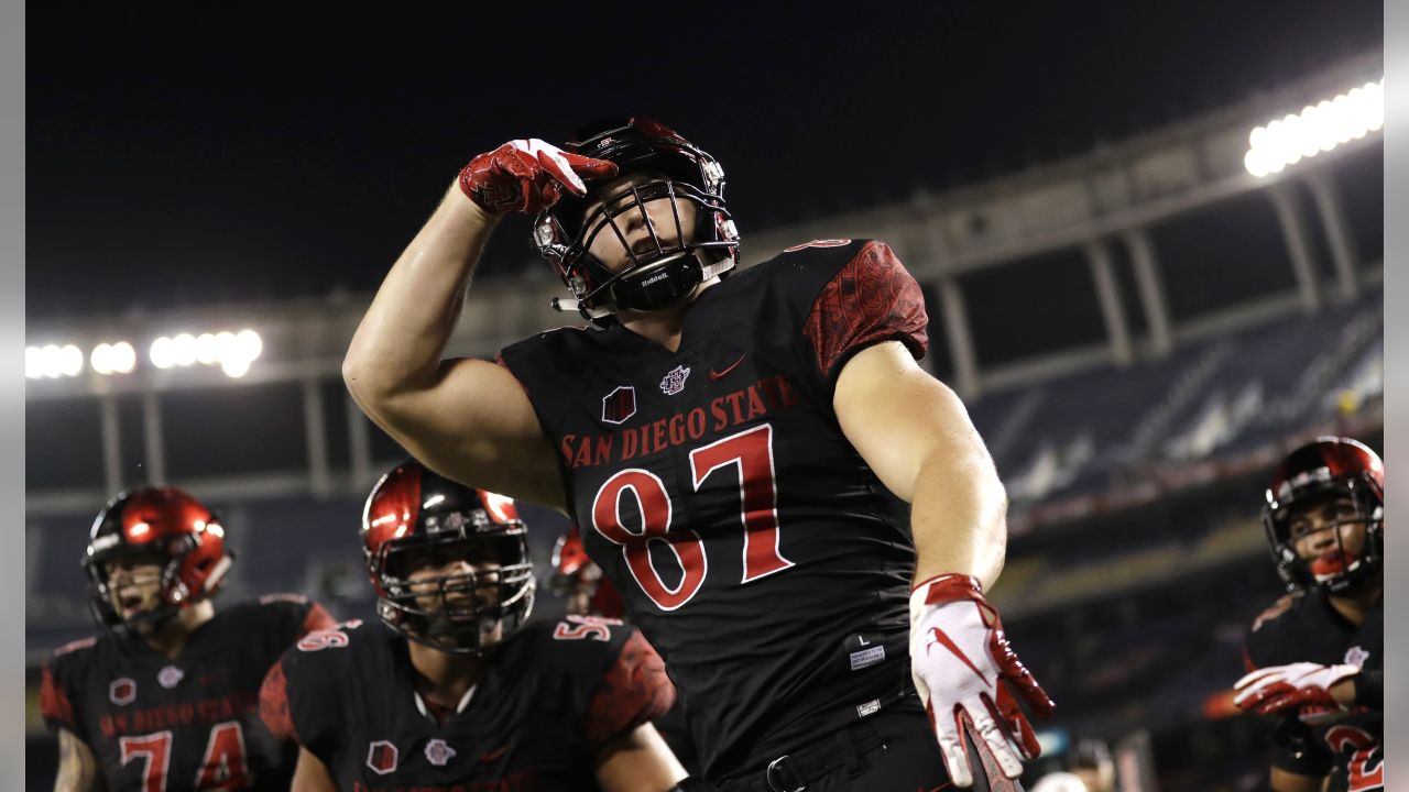 San Diego State tight end Kahale Warring, center, reacts after scoring a two-point conversion during the second half of an NCAA college football game against Arizona State Saturday, Sept. 15, 2018, in San Diego. (AP Photo/Gregory Bull)