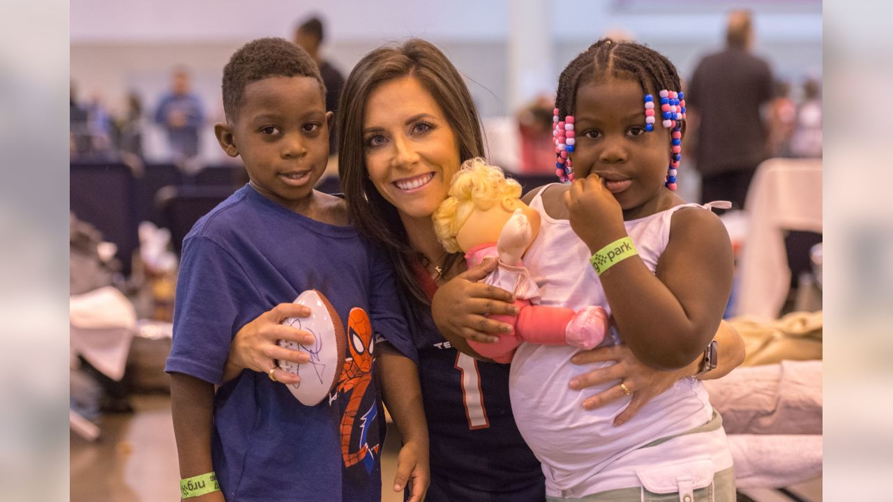 On August 31, 2017, Houston Texans players and families visit displaced Houstonians evacuated to NRG Park in the aftermath of Hurricane Harvey.