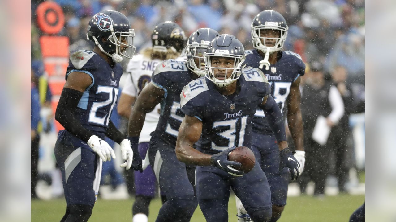 Tennessee Titans safety Kevin Byard (31) runs to the sideline after intercepting a pass against the Baltimore Ravens in the first half of an NFL football game Sunday, Oct. 14, 2018, in Nashville, Tenn. (AP Photo/James Kenney)