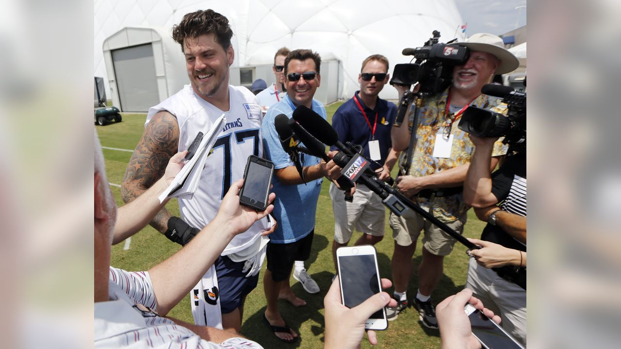 Tennessee Titans offensive tackle Taylor Lewan (77) answers questions following the first day of practice at NFL football training camp Thursday, July 26, 2018, in Nashville, Tenn. (AP Photo/Mark Humphrey)