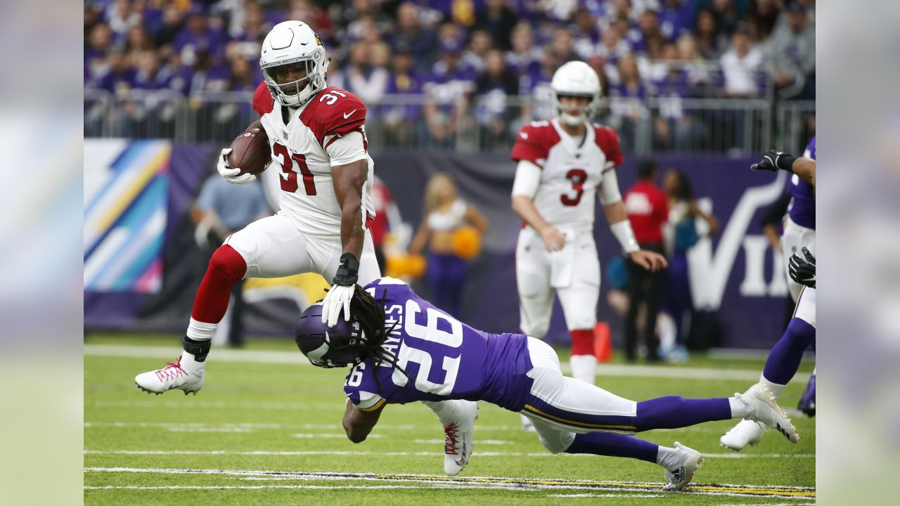 Arizona Cardinals running back David Johnson (31) breaks a tackle by Minnesota Vikings cornerback Trae Waynes (26) during the first half of an NFL football game, Sunday, Oct. 14, 2018, in Minneapolis.