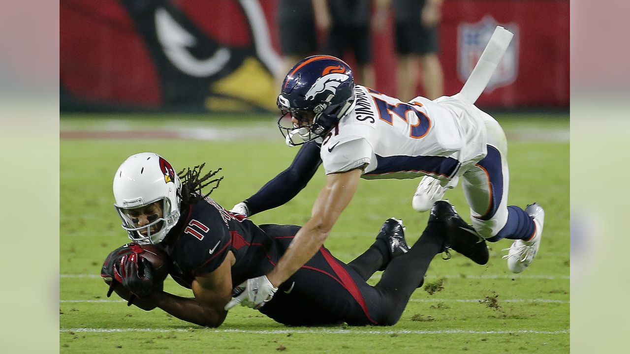 Arizona Cardinals wide receiver Larry Fitzgerald (11) is tackled by Denver Broncos free safety Justin Simmons (31) during the first half of an NFL football game, Thursday, Oct. 18, 2018, in Glendale, Ariz.