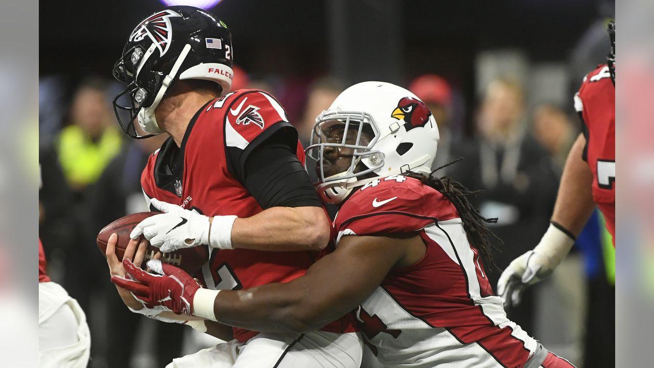 Arizona Cardinals defensive end Markus Golden (44) sacks Atlanta Falcons quarterback Matt Ryan (2) during the first half of an NFL football game, Sunday, Dec. 16, 2018, in Atlanta.