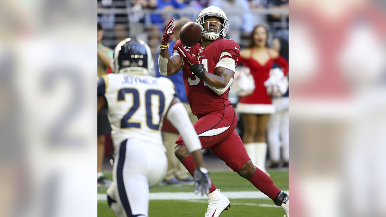 Cardinals running back David Johnson (31) pulls in a touchdown pass from wide receiver Larry Fitzgerald as Los Angeles Rams free safety Lamarcus Joyner (20) pursues during the first half of an NFL football game, Sunday, Dec. 23, 2018, in Glendale, Ariz.