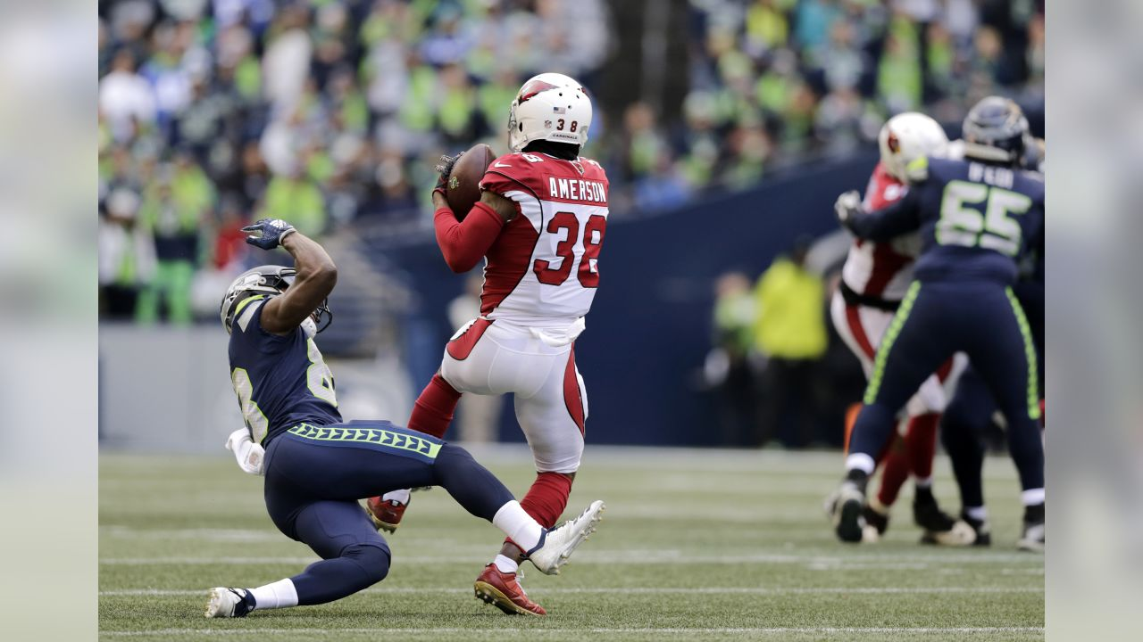 Arizona Cardinals' David Amerson (38) intercepts the ball in front of Seattle Seahawks' David Moore during the first half of an NFL football game, Sunday, Dec. 30, 2018, in Seattle.