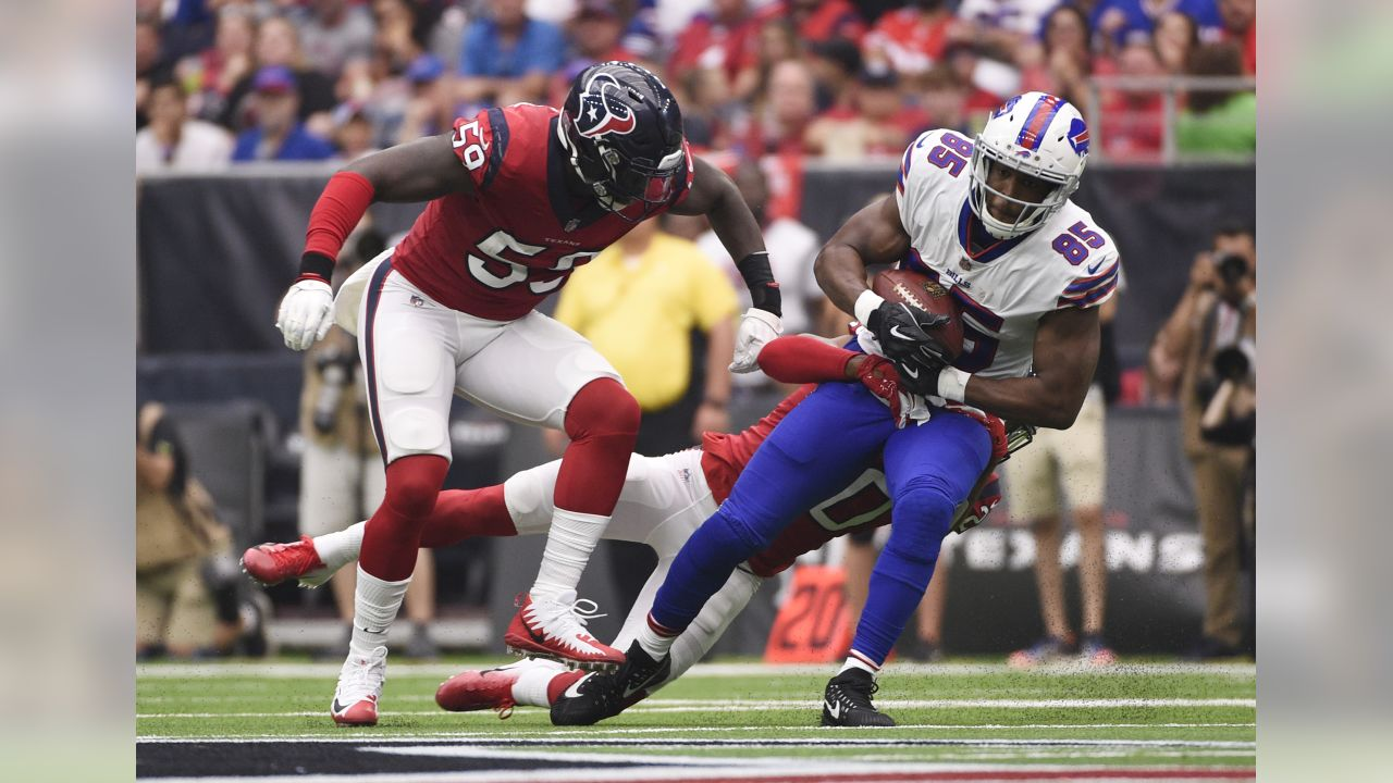 Buffalo Bills tight end Charles Clay (85) is hit by Houston Texans defensive back Justin Reid (20) after a catch during the first quarter of an NFL football game, Sunday, Oct. 14, 2018, in Houston.