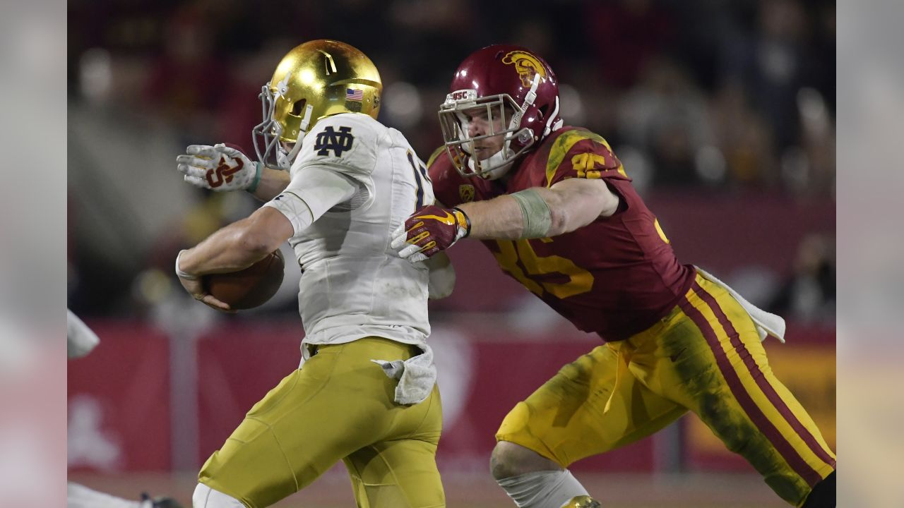 Southern California linebacker Cameron Smith, right, tackles Notre Dame quarterback Ian Book during the second half of an NCAA college football game Saturday, Nov. 24, 2018, in Los Angeles. Notre Dame won 24-17. (AP Photo/Mark J. Terrill)